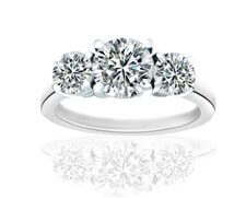 Plain 3 stone engagement ring with round shaped diamonds