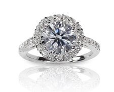 Halo engagement ring with round shaped stone