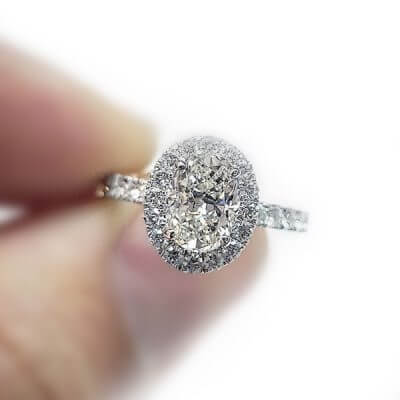 Oval Shaped Halo Style Diamond Engagement Ring