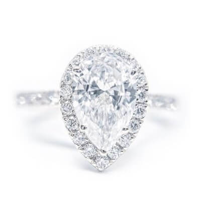 Classic Pear Shaped Halo Style Diamond Engagement Ring